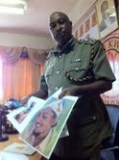 Kenya Police spokesman, Eric Kiraithe, with photos of inurgents from Somalia