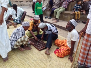 Men playing Bao, a traditional board game, Lamu town